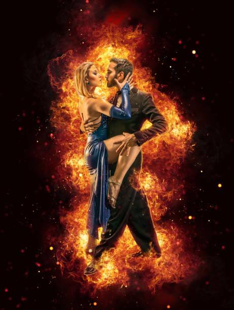 argentine couple dancing tango in buenos aires argentina surrounded by flames - tango taniec zdjęcia i obrazy z banku zdjęć
