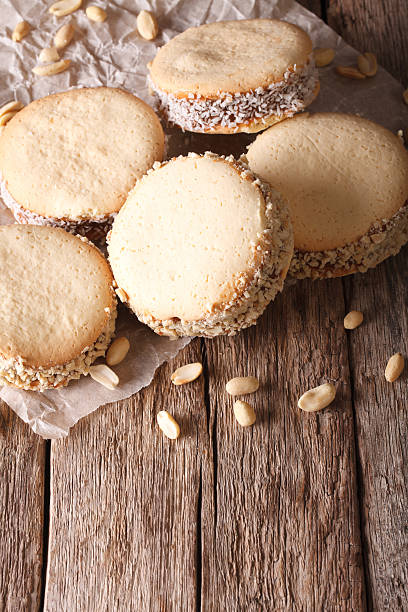 Argentine cuisine: alfajores with cream on paper close-up - foto de stock