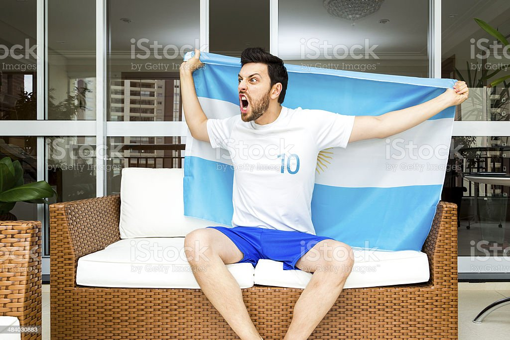 Argentine fan celebrates at home stock photo
