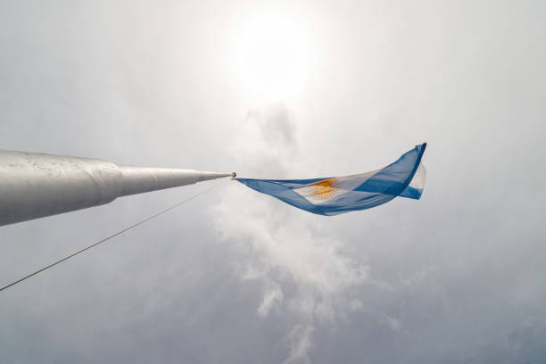 Argentine flag seen from below with solar backlight stock photo