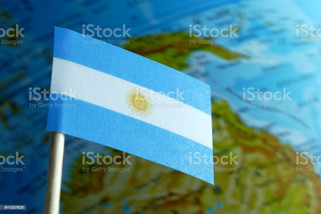Argentine flag with a globe map as a background macro stock photo