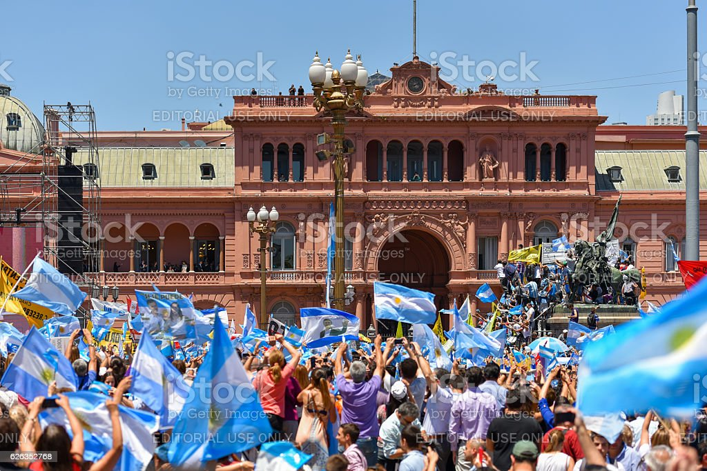 Argentine people wave flags in front of the government house stock photo