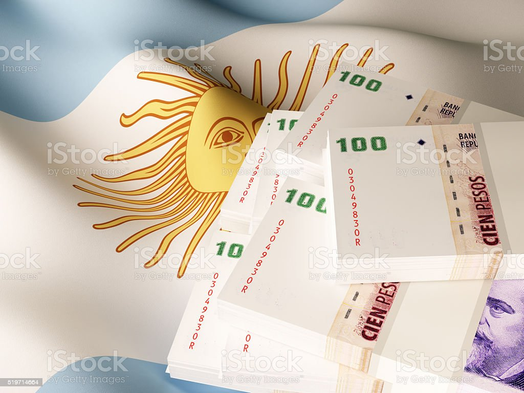 Argentine peso banknotes over Argentina flag stock photo