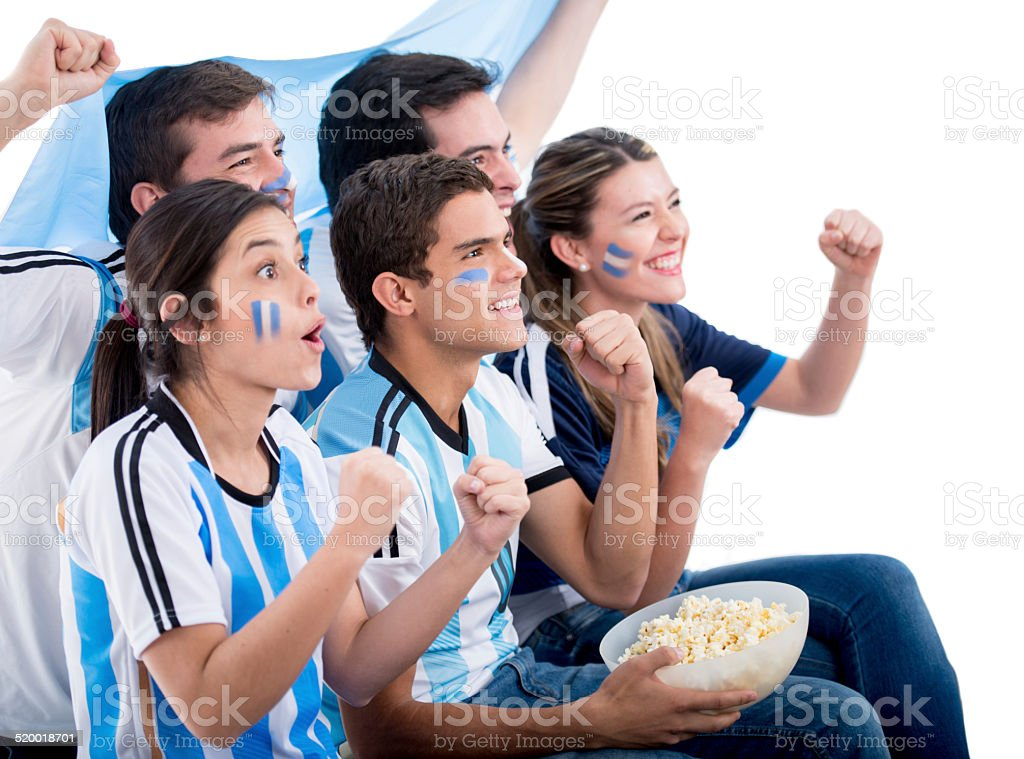 Argentinean football fans watching the game stock photo