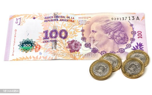 Argentinian banknote with the image of Eva Peron, (Evita), and coins.