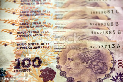 Argentinian banknotes with the image of Eva Peron, (Evita). Selective focus.