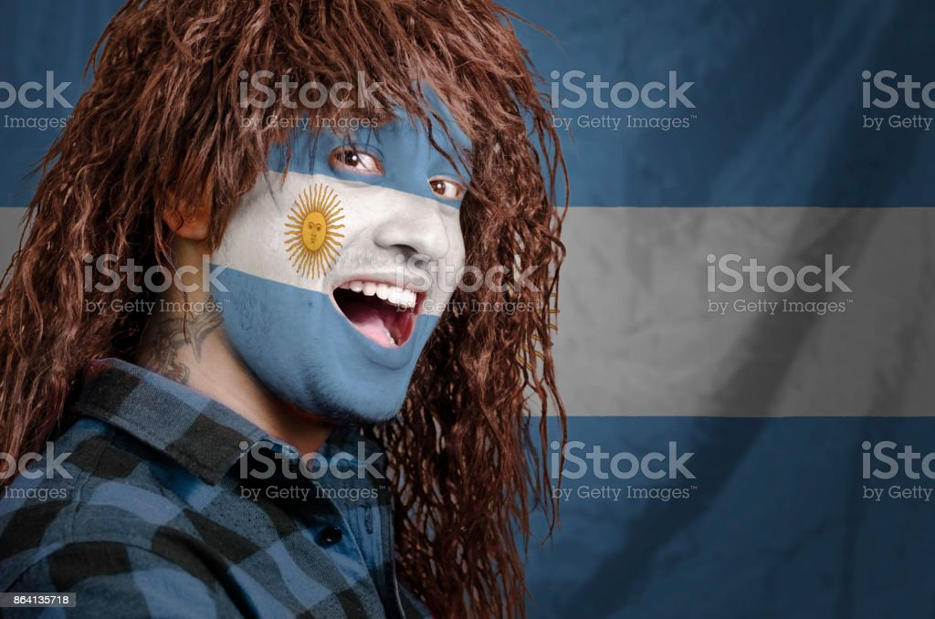 Argentinian fan with face painted stock photo