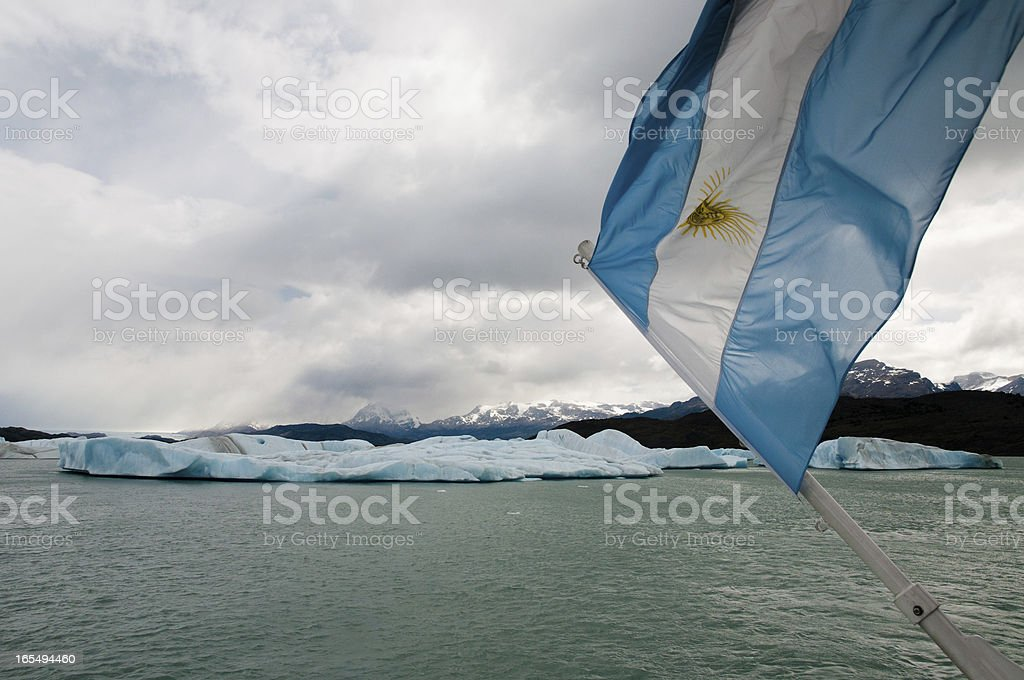 Argentinian Flag in front of floating Icebergs, Patagonia (Argentina) royalty-free stock photo