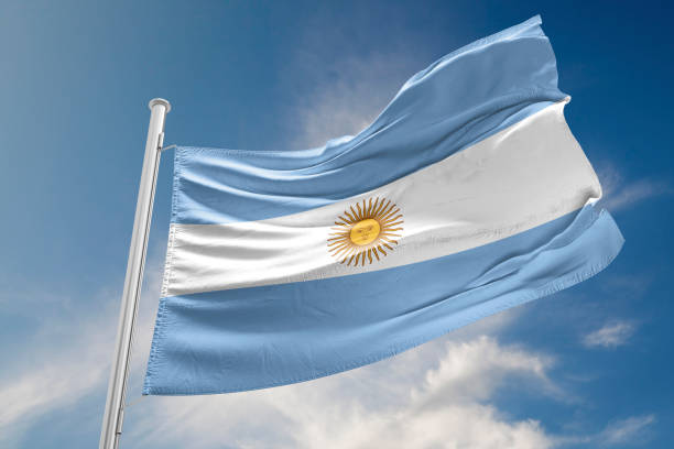 Argentinian Flag is Waving Against Blue Sky stock photo