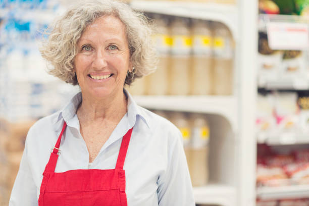 Argentinian senior woman worker of a supermarket stock photo