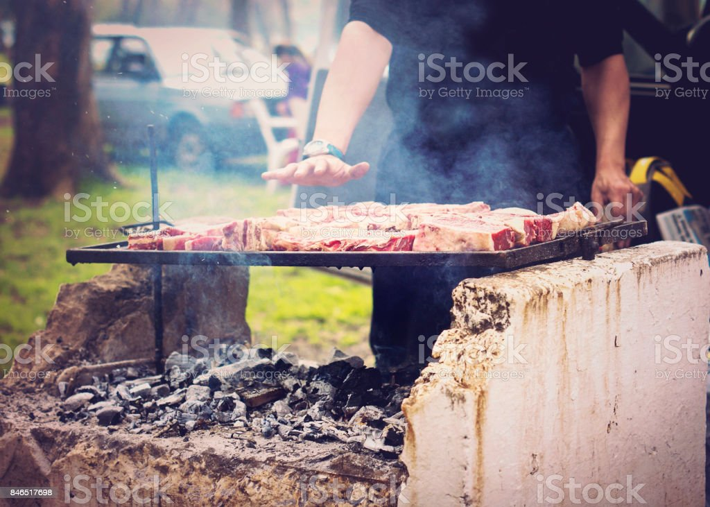 Argentinian steak. making a typical Argentinian  asado in a park stock photo