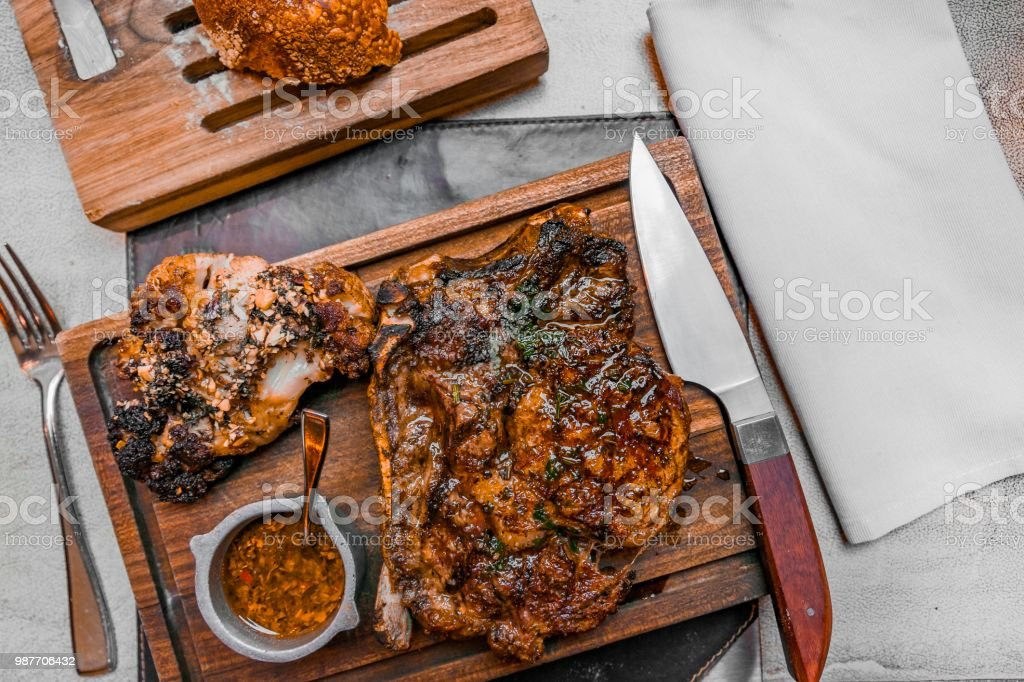 Argentinian steak served with chargrilled cauliflower and chimichurri sauce, at a high end restaurant at Buenos Aires, Argentina. stock photo