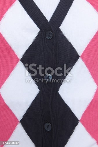 Argyle button cardigan sweater in pink blue white fully buttoned to the neckline.