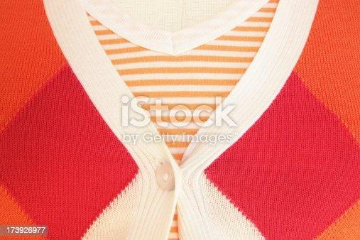 Argyle sweater fashionable orange feminine clothing ensemble with striped mate.