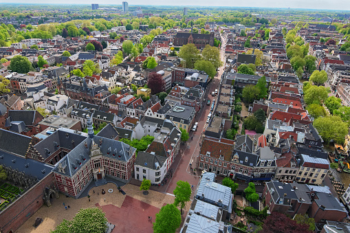 Arial view from the top of the tower of the St. Martins Cathedral at sunny day. Beautiful view of streets with ancient buildings of Utrecht. Popular travel destination in the Netherlands