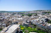 Arial view of white buildings town and green Gozo island and villages from the old medieval Cittadella tower castle, also known as Citadel, Castello in the Victoria Rabat town, Malta