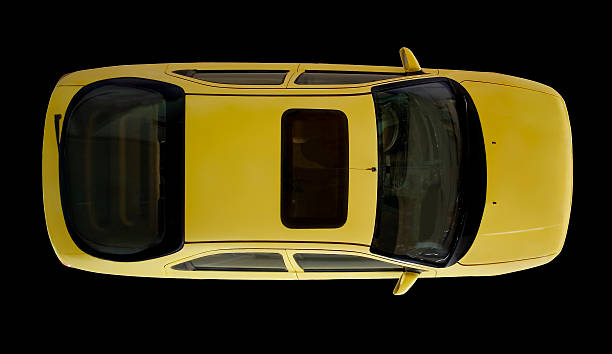 Arial view of yellow car isolated on black stock photo