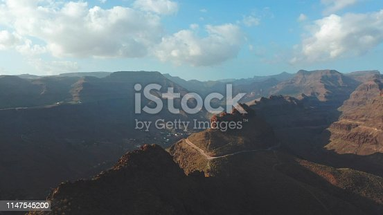 Drone flying above majestic mountains. Dry canyon