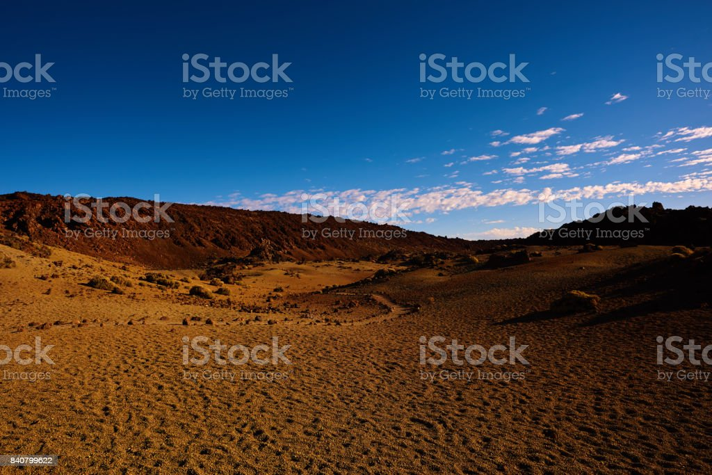 horizontal nature background of arid and volcanic landscape in...