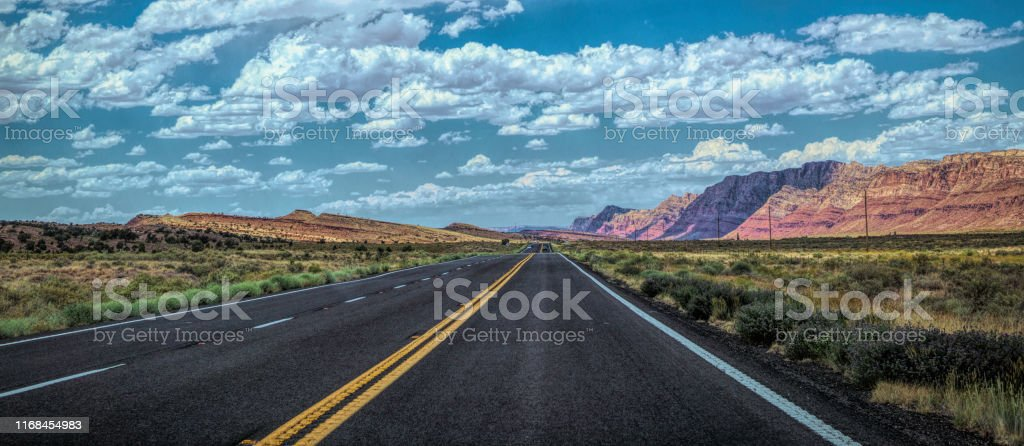 Arid summer in Arizona, USA. The crumbling sandstone rocks, modern...