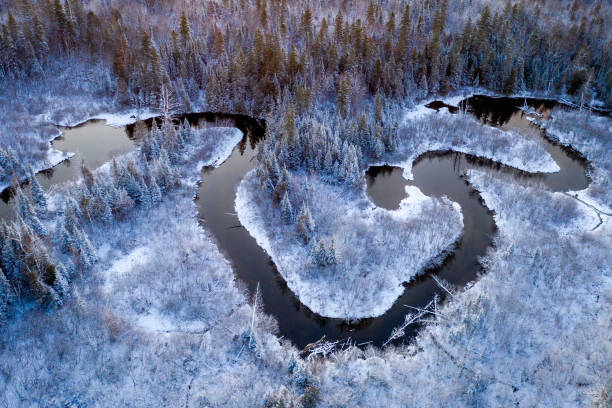 Ariel view of a winding creek in winter stock photo