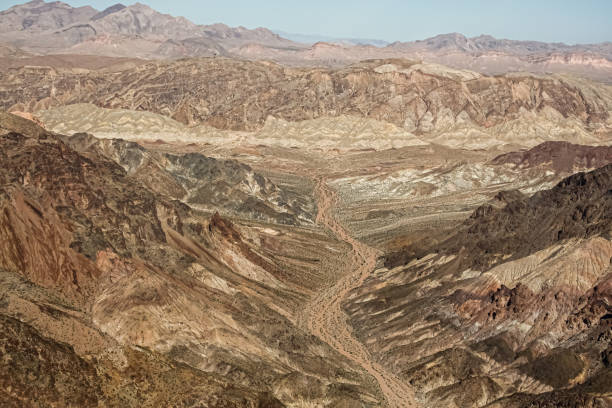 Ariel view of desert road in valleys. stock photo