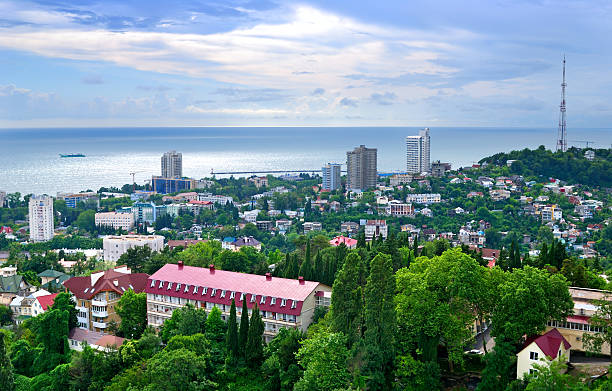 Ariel view of Sochi under bright skies Panorama of a city Sochi. sochi stock pictures, royalty-free photos & images