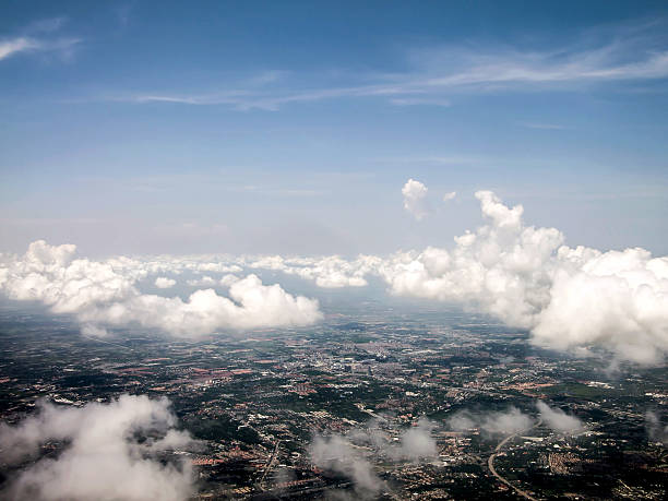 Ariel view of the city through the clouds stock photo