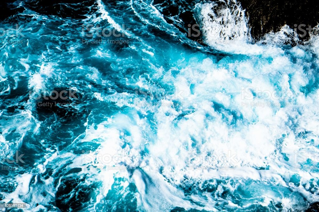 Ariel View Of Water Churning In Ocean Stock Photo - Download Image