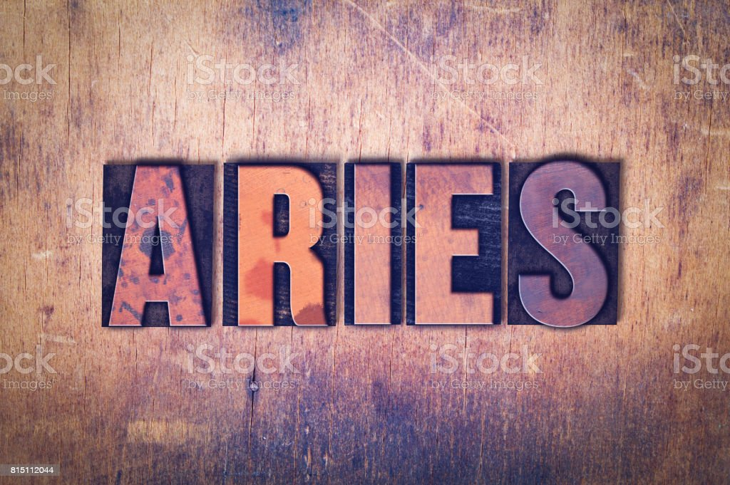 Aries Theme Letterpress Word on Wood Background stock photo