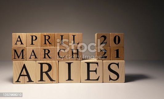 810006098 istock photo Aries word on wooden cubes on white background. 1252968010