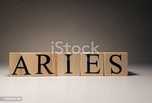 810006098 istock photo Aries word on wooden cubes on white background. 1253009165