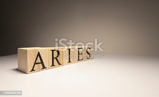 810006098 istock photo Aries word on wooden cubes on white background. 1253009208