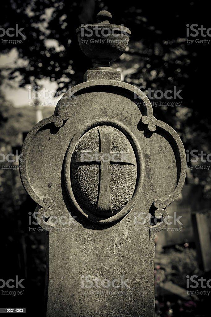 Aristocrat tombstone between darkness royalty-free stock photo