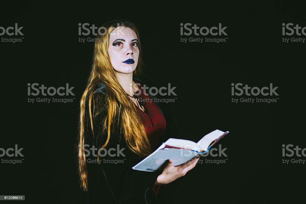 Aristocratic Vampire Redhead Woman Reading Book stock photo
