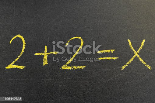 istock arithmetic equation 2 + 2, written in a lesson on a blackboard for teaching students science 1196442313