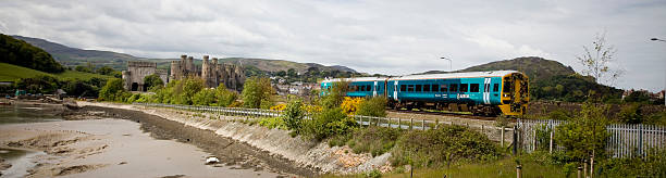 Ariva Trains Wales Train diesel Unit Passes Conwy Castle stock photo