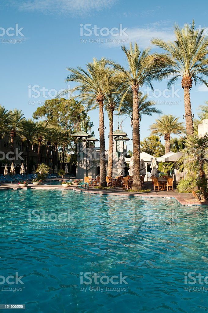 Arizona Biltmore Hotel swimming pool at noon with palm trees royalty-free stock photo