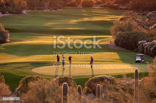 Phoenix, Arizona, United States - December 9, 2014: A group of golfers on a beautiful desert golf course in Phoenix, Arizona. Phoenix is one of the world's most popular golf destinations.