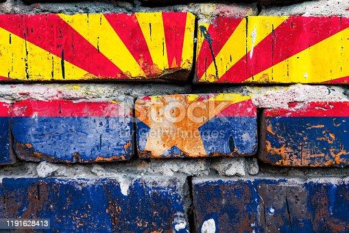 Arizona grunge, damaged, scratch, old style Arizona flag on a brick wall.