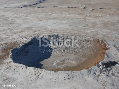Aerial view of the Arizona Meteor Crater near Flagstaff, AZ, wintertime.  For scale, see the single bus parked on the black tarmac on the right