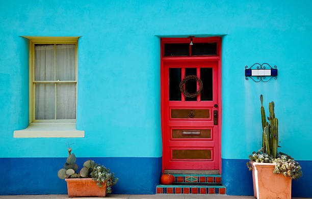 Arizona, Mexico Blue Stucco Wall and Red Door