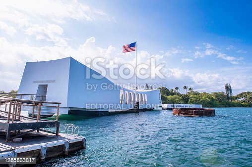 The USS Arizona Memorial in Pearl Harbor, Oahu, Hawaii view from a shuttle boat arriving at the pier at Honolulu, Hawaii, USA.