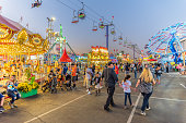 People throng the midway at the Arizona State Fair in Phoenix during the evening hours.
