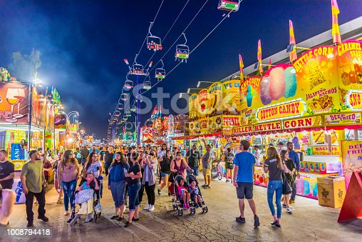 People stroll down the main thoroughfare at the Arizona State Fair in Phoenix.