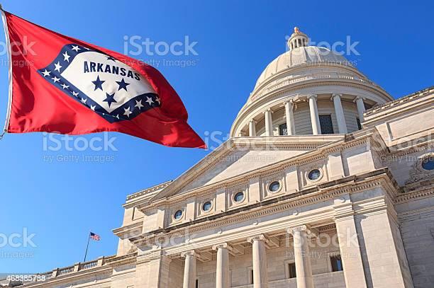 Arkansas flag flying high beside the state capitol building picture id468385788?b=1&k=6&m=468385788&s=612x612&h=jtc kpzymbobjwhl7emk8csic 6jii3w0nsqxn1cqcg=
