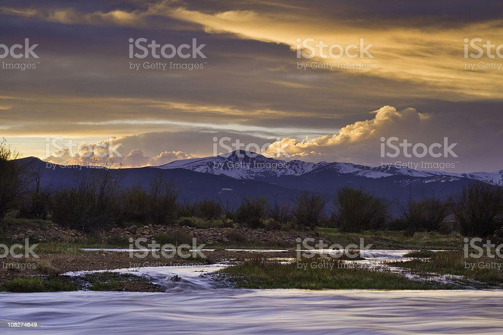 Arkansas River and Mountains at Sunset in Colorado stock photo