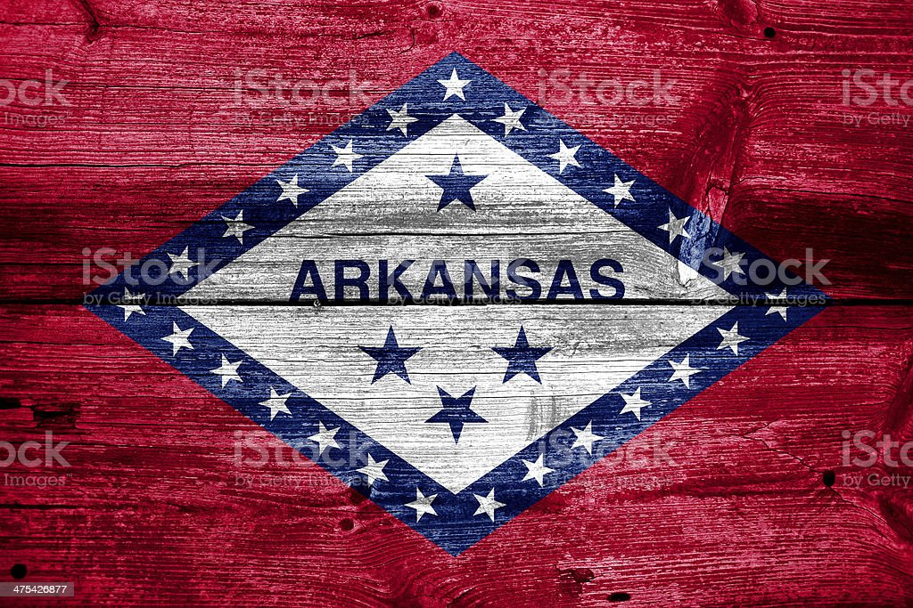 Arkansas State Flag painted on old wood plank texture royalty-free stock photo