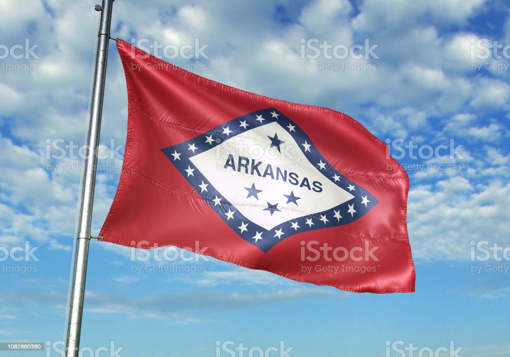 Arkansas state of United States flag on flagpole waving cloudy sky...