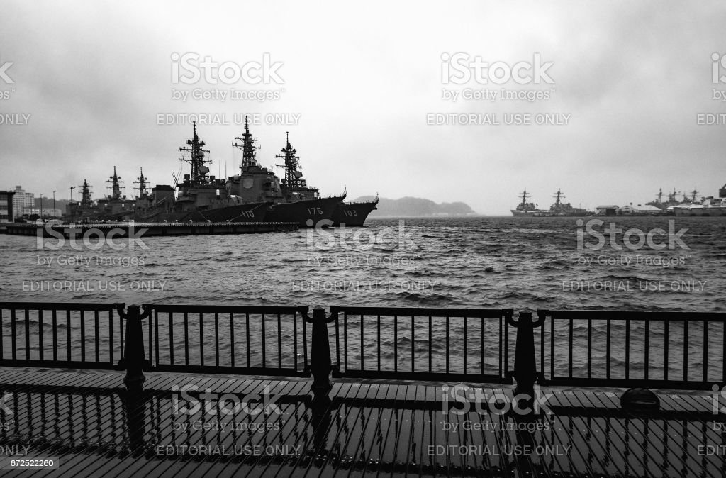 Arleigh Burke-class destroyers anchored in stormy waters at the United States Fleet Activities Yokosuka Navy base stock photo
